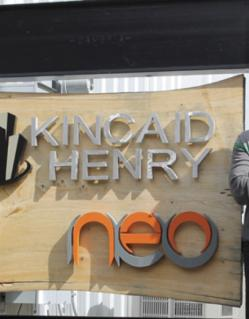 Kincaid Henry standing in front of the NEO Center